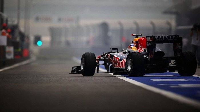formula one car in black red bull written on it in red cool wallpapers for boys photographed on the race track