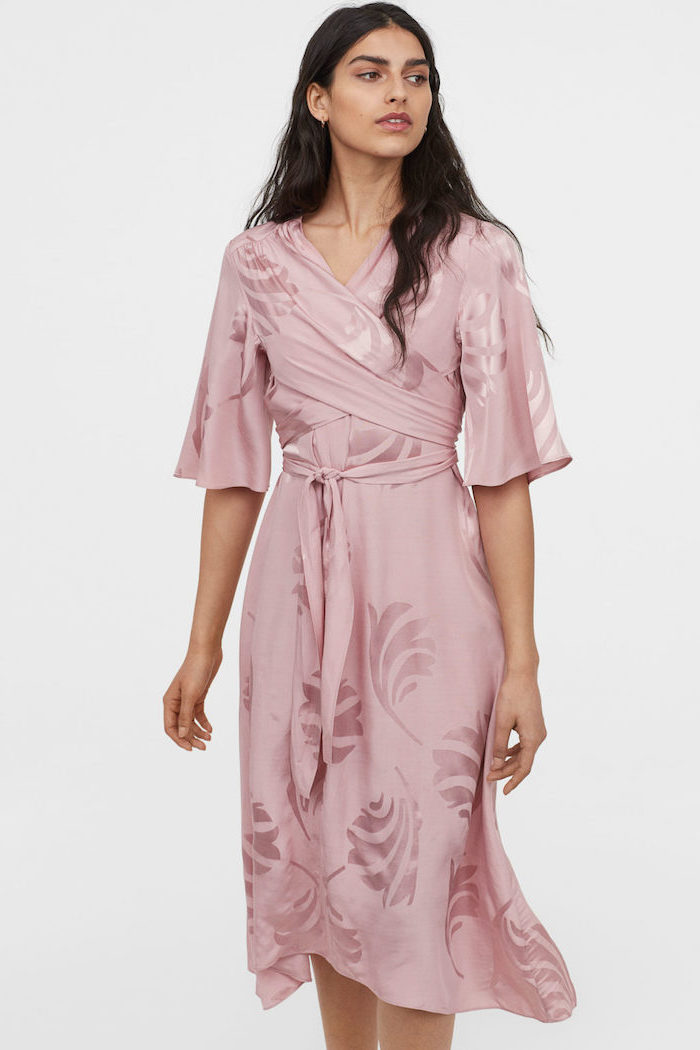 girl with long black wavy hair wearing pink satin wrap around dress long sleeve wedding guest dresses