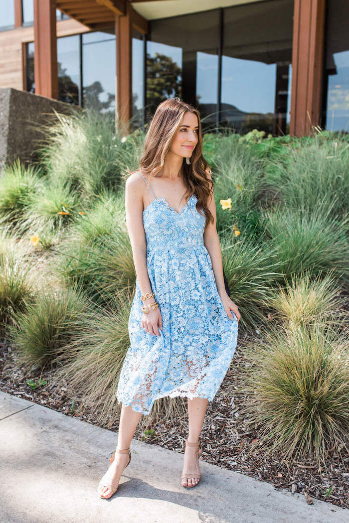 girl with long brown wavy hair wearing blue lace dress long sleeve wedding guest dresses nude sandals