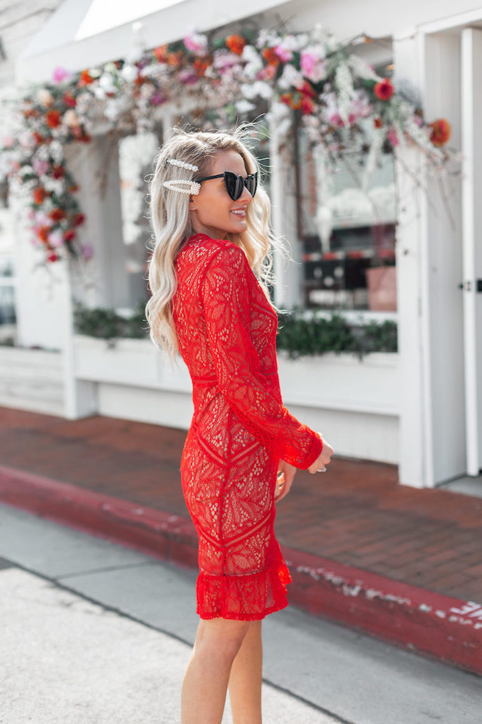 girl with long wavy blonde hair wedding guest outfits wearing red lace dress with long sleeves