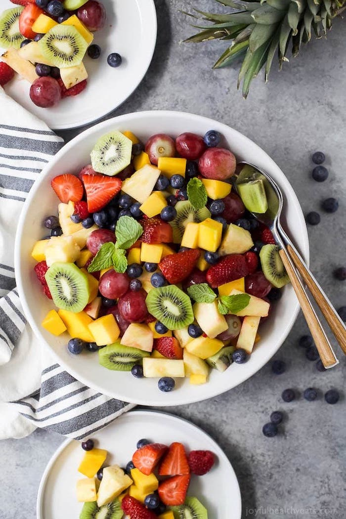 grapes kiwi mango pineapple strawberries blueberries how to make salad inside white bowl