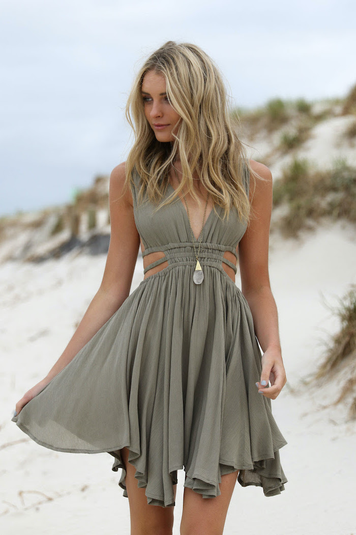 green pastel dress worn by woman with medium length blonde wavy hair womens casual summer dresses standing on the beach