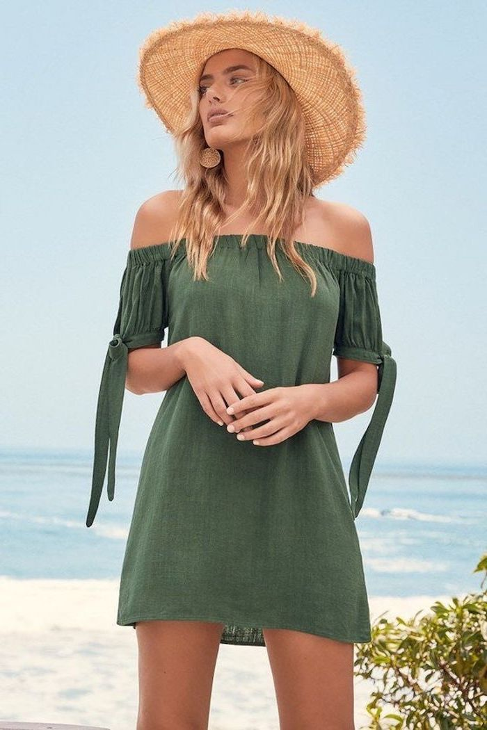 green strapless dress worn by woman with medium length wavy blonde hair spring dresses for women straw hat