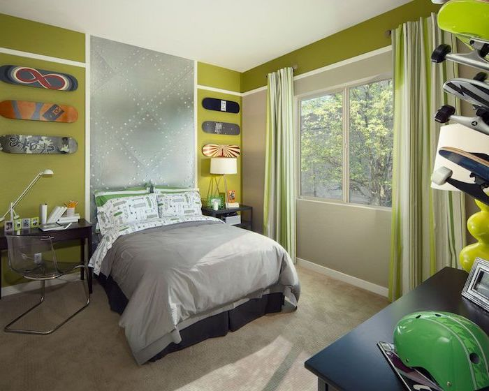 green walls with skateboards hanging on them above the bed boys bedroom ideas small desk on the side of the bed