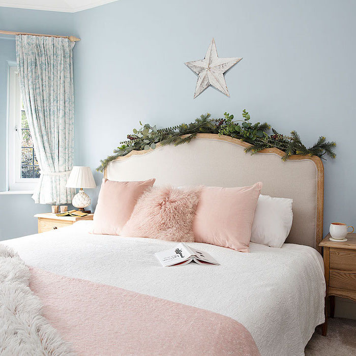 greenery over the bed frame pinterest bedroom ideas bed with white bed sheets pink throw pillows blanket blue walls