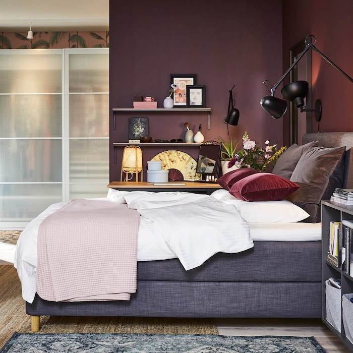 grey bed frame white bed sheets pink blanket red velvet throw pillows cute bedroom ideas dark purple walls