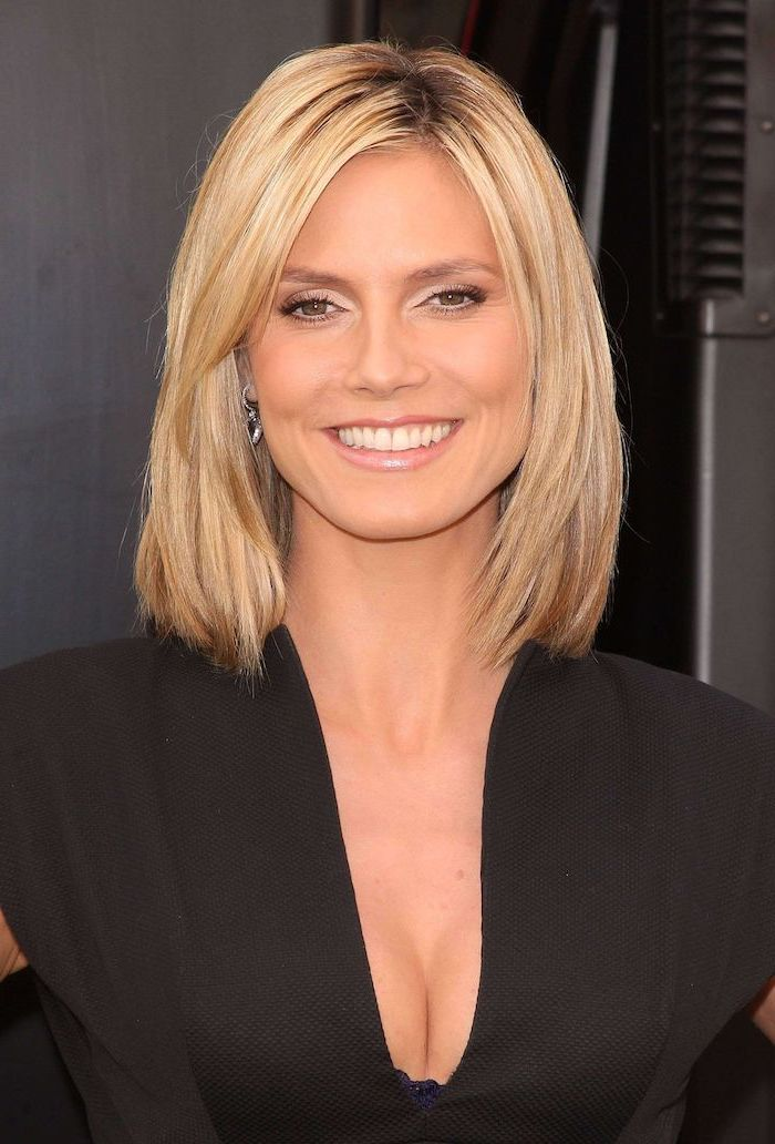 hairstyles for thin hair heidi klum wearing black dress with shoulder length blonde hair smiling at the camera
