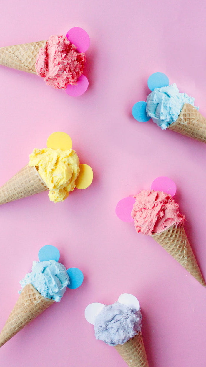 ice cream scoops in different colors arranged on pink background beautiful wallpaper for phone pink blue yellow purple ice cream