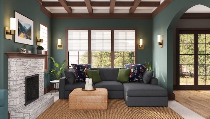 interior paint colors dark grey corner sofa with green throw pillows dark green walls exposed wood beams on the ceiling stone fireplace