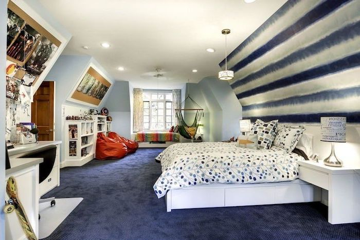 large bedroom with twin bed teen boy bedroom ideas dark blue carpet hammock two puff chairs wooden desk bookshelves