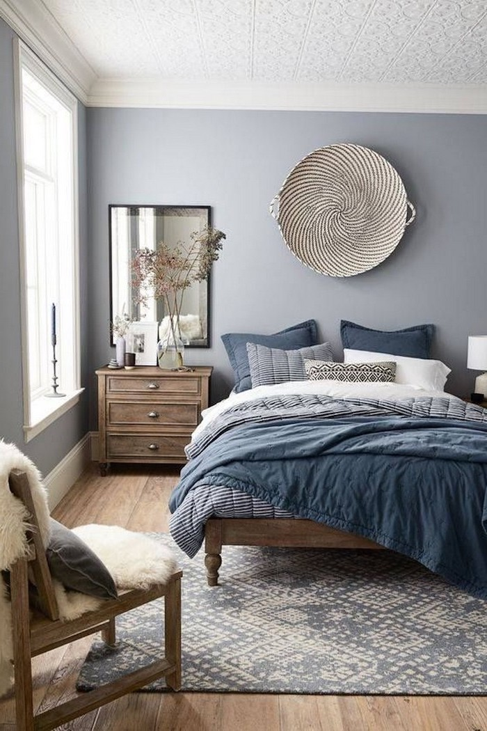 light grey walls bedroom ideas for women bed with wooden bed frame wooden floor with grey carpet wooden armchair