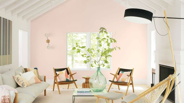 light pastel pink walls white cathedral ceiling white sofa wooden armchairs arranged in front of fireplace interior paint colors