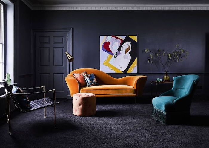living room paint color ideas black walls and carpet orange velvet sofa turquoise velvet armchair colorful wall art