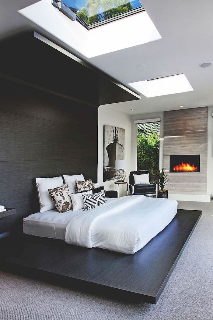 master bedroom ideas with fireplace large black wooden board windows on the ceiling floor covered with grey carpets