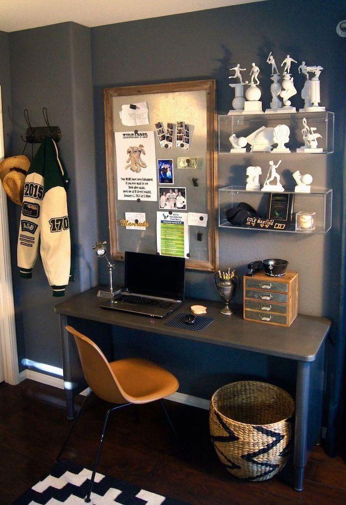 metal desk with laptop magnetic board on the grey wall orange chair plastic bookshelf boys room colors wooden floor