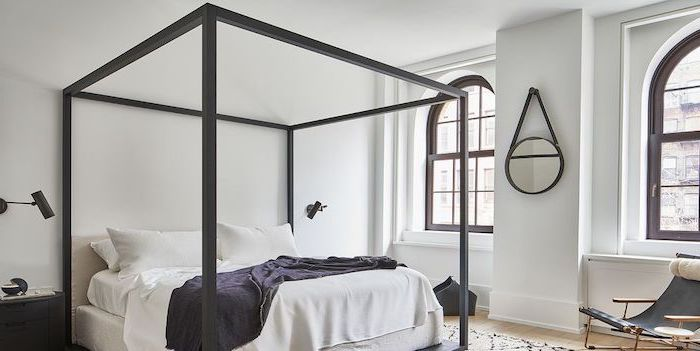 metal railing around the bed with white bed sheets master bedroom ideas wooden floor white walls