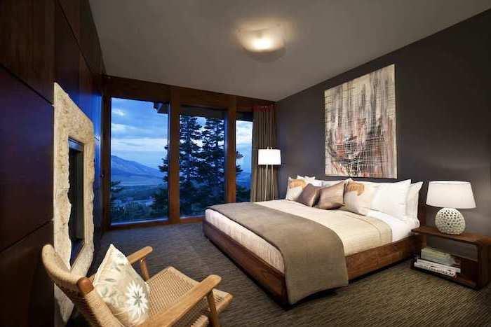 modern bedroom ideas black accent wall wooden walls dark grey carpet covering the floor wooden armchair