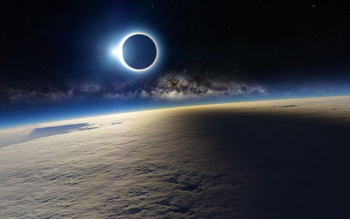 photograph from space taken above the clouds cool wallpapers for boys moon eclipsing the sun