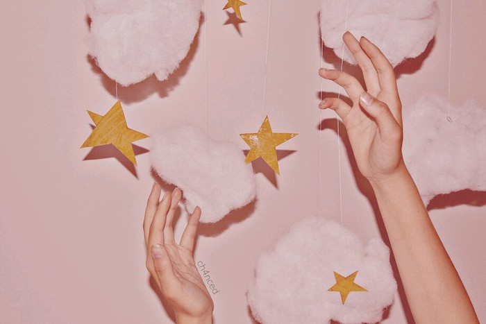 pink cotton clouds gold carton stars on strings hanging on pink wall cute wallpapers for girls