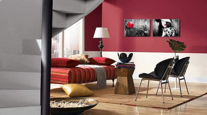 red and white walls with wall art living room paint color ideas two black chairs red ottoman wooden coffee table