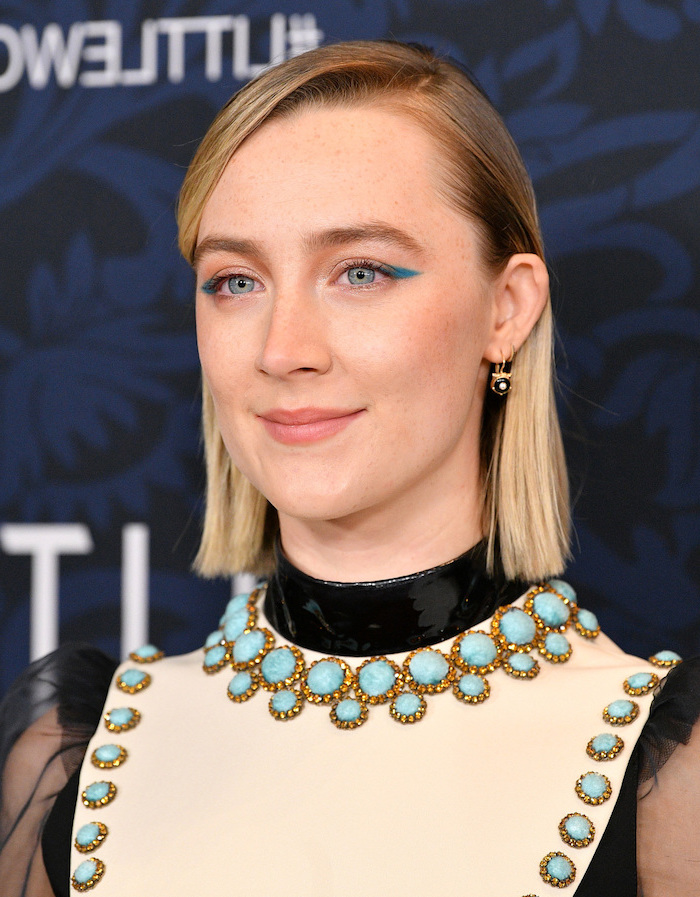 saoirse ronan wearing white and black dress with blue rhinestones haircut for thin hair to look thicker side swept short straightened blonde hair