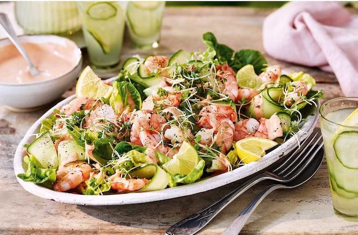 shrimp salad with cucumbers sprouts green salad summer salad recipes lemon sliced on the sides
