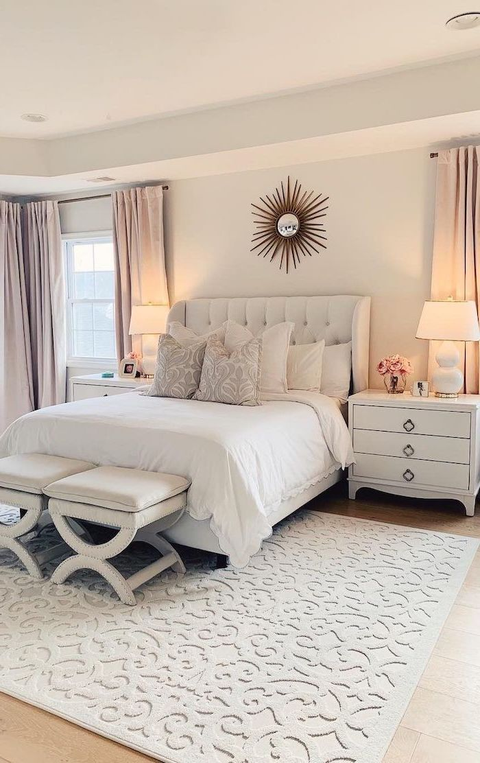 small bedroom with wooden floor white walls bedroom decor ideas white carpet two ottomans in front of the bed