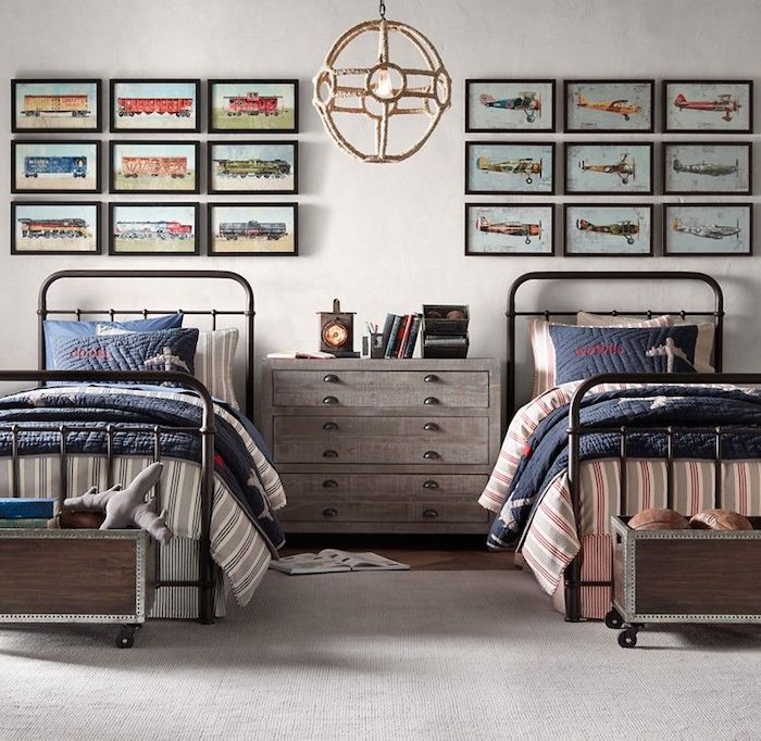 teen boy bedroom ideas two beds with night stand between them framed photos of trains and airplanes above the beds