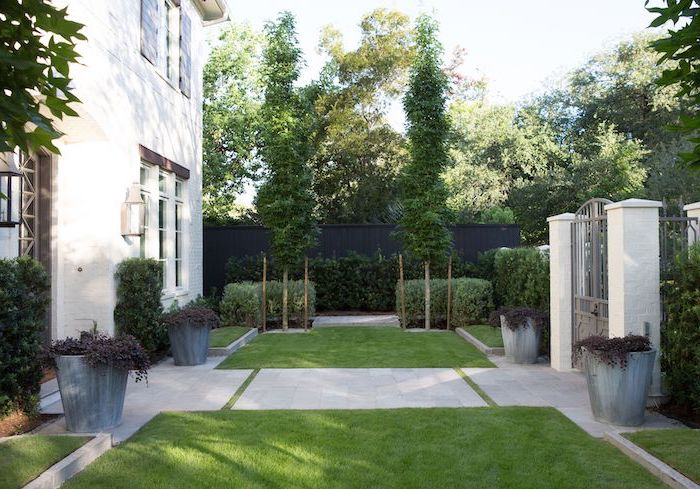 white tiled pathway surrounded by grass leading from gate to front door landscaping ideas for front of house surrounded by bushes