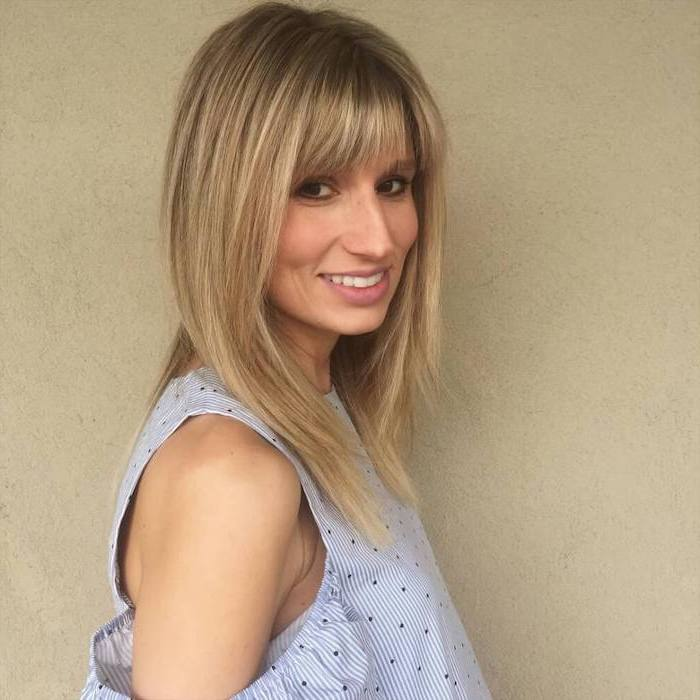 woman wearing white and blue striped shirt short haircuts for thin hair dark blonde hair with blonde highlights straightened with bangs