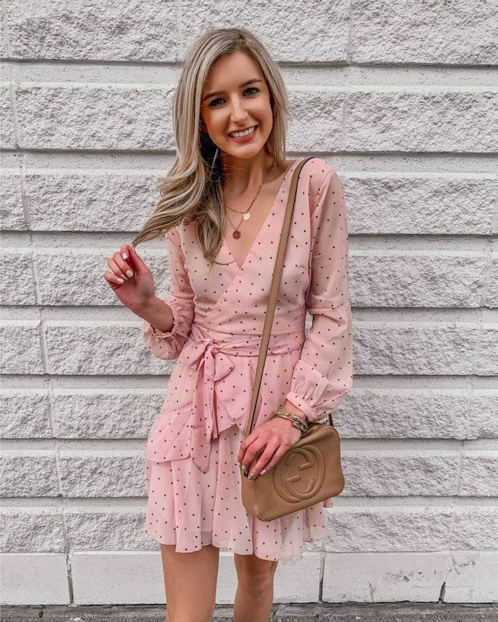 woman with blonde hair wearing pink dress with black dots cute summer dresses brown leather crossbody bag