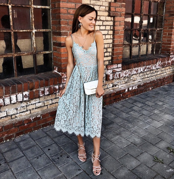 woman with brunette hair wearing light blue lace dress wedding guest dresses wearing white sandals crossbody bag