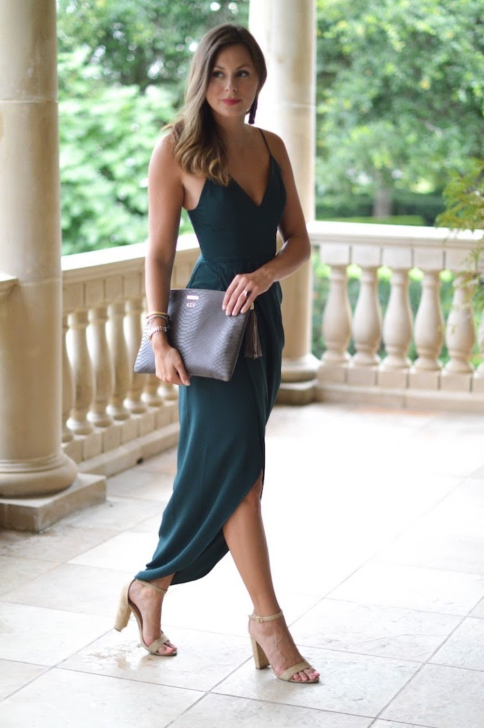 woman with dark blonde hair wearing dark green dress formal dresses for weddings nude sandals with dark grey clutch leather bag