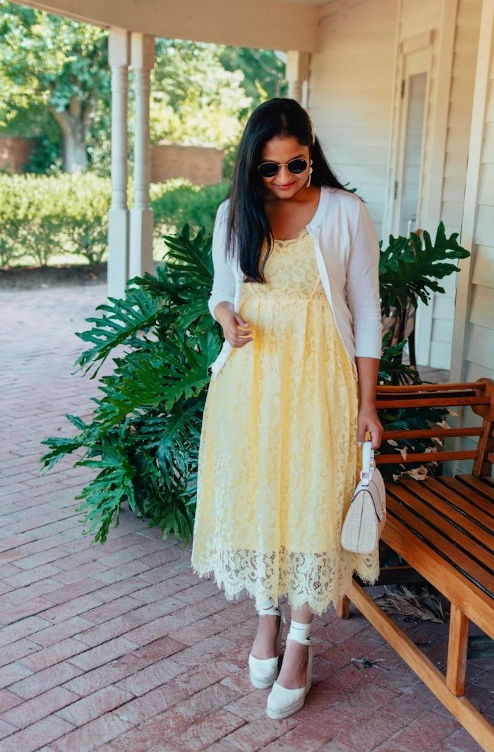 woman with long black hair wearing yellow lace midi dress white cardigan beautiful dresses to wear to a wedding white platform sandals bag