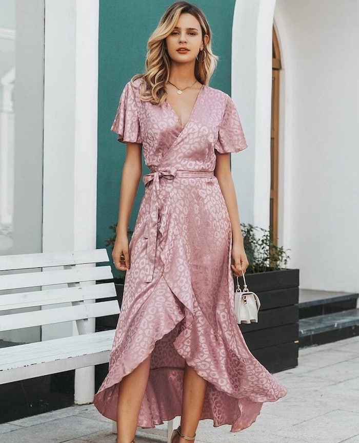 woman with medium length wavy blonde hair formal dresses for weddings wearing satin wrap around dress with colorless leopard print