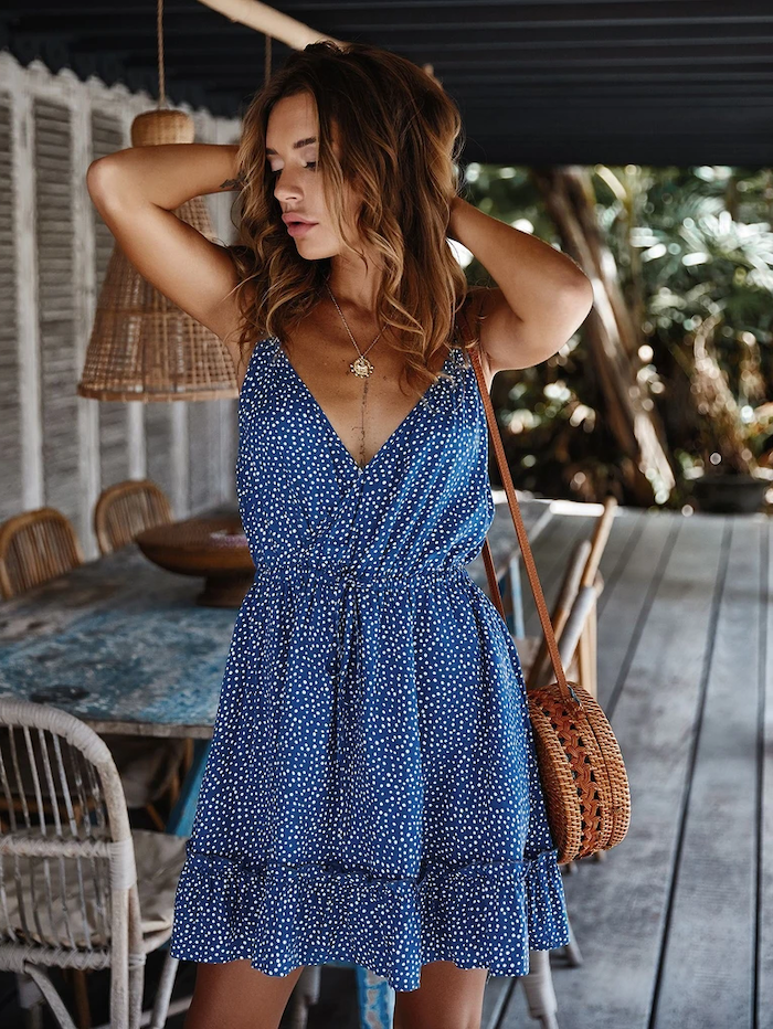 womens dresses brunette woman with medium length wavy hair wearing blue dress with white dots