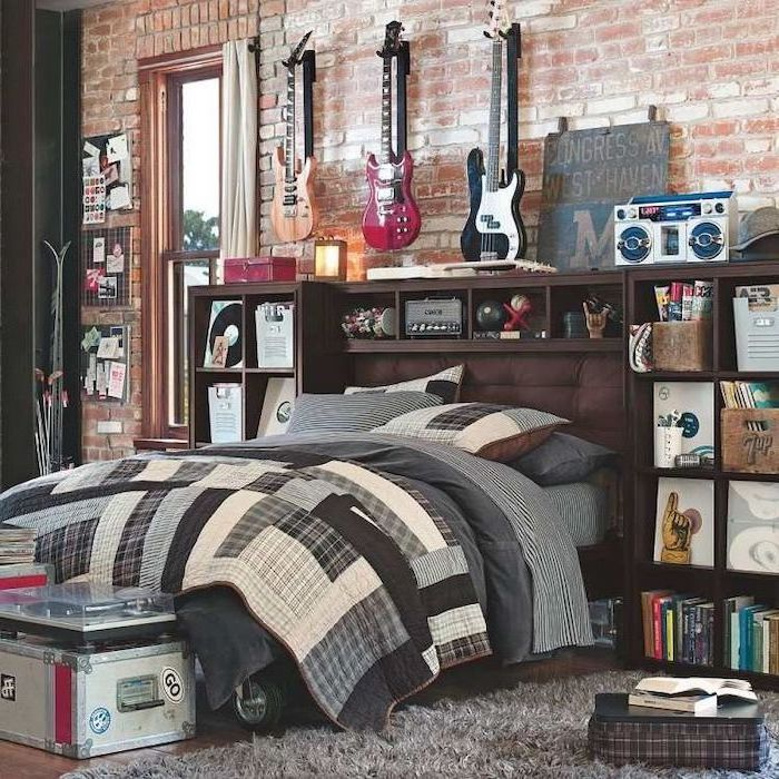 wooden floor with grey carpet boys bedroom ideas brick wall with guitars hanging on it vinyls boombox arranged on shelves around the bed
