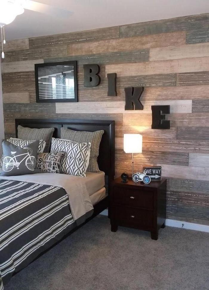 wooden wall bike written on it teen boy bedroom ideas black and grey bed sheets wooden night stand next to the bed