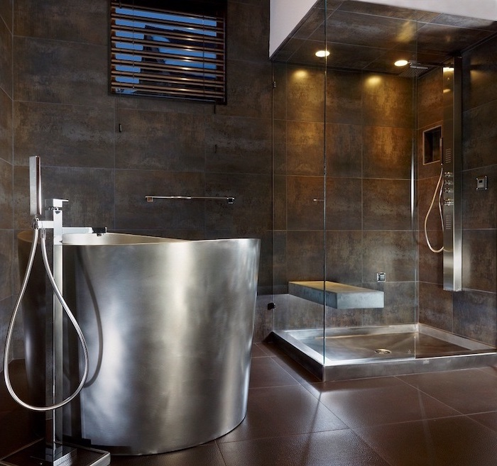 bathroom decor ideas stainless steel bathtub dark brown tiles on walls and floor glass shower cabin