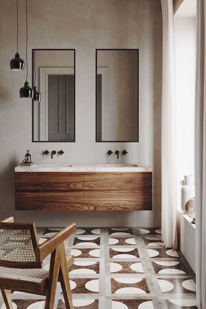 bathroom picture ideas floating wooden cabinets with two sinks two mirrors above them tiles with pattern in brown gray and white on the floor