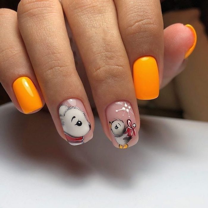 bear and bird decorations on middle and ring fingers orange nail polish on other fingers simple nail designs short squoval nails