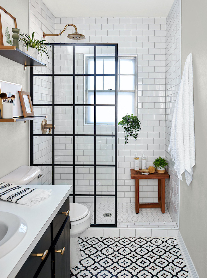 black cabinet with white countertop small bathroom designs with shower black and white patterned floor subway tiles arounf the shower
