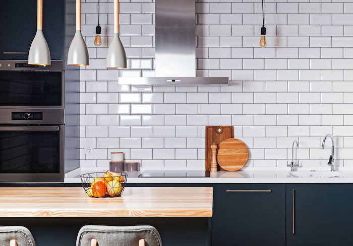 black cabinets with white countertops kitchen tile backsplash ideas white subway tiles kitchen island with wooden countertop
