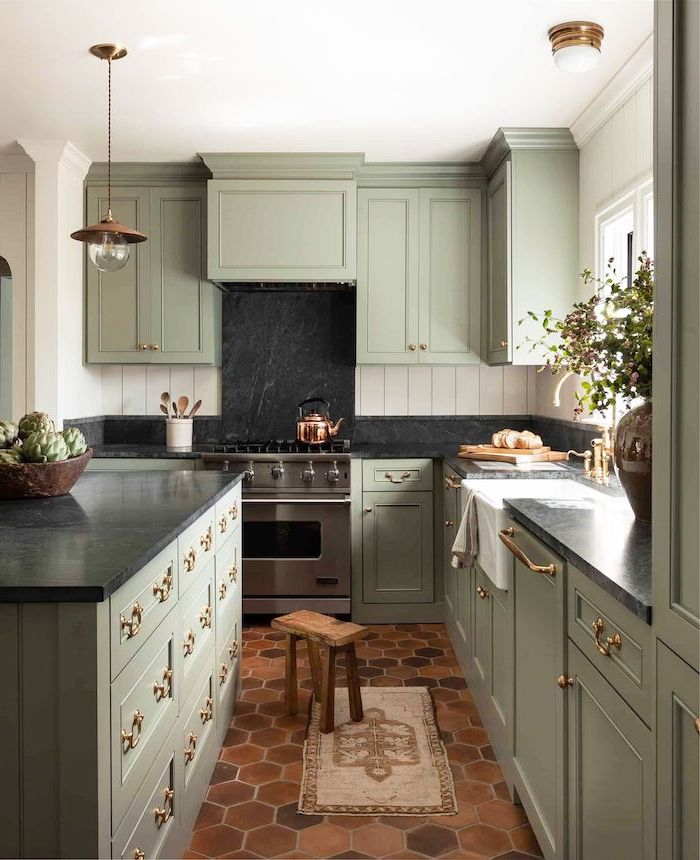 black granite backsplash light pastel green cabinets with black countertops farmhouse white kitchen cabinets honeycomb tiles on the floor