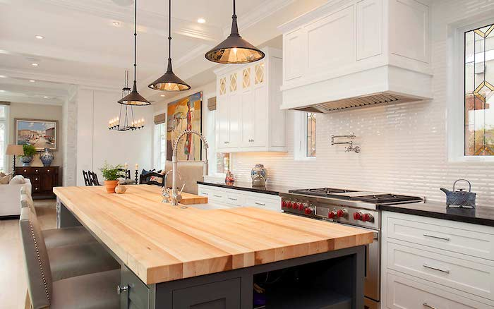 black kitchen island with wooden countertop velvet bar stools modern farmhouse kitchen decor white subway tiles backsplash