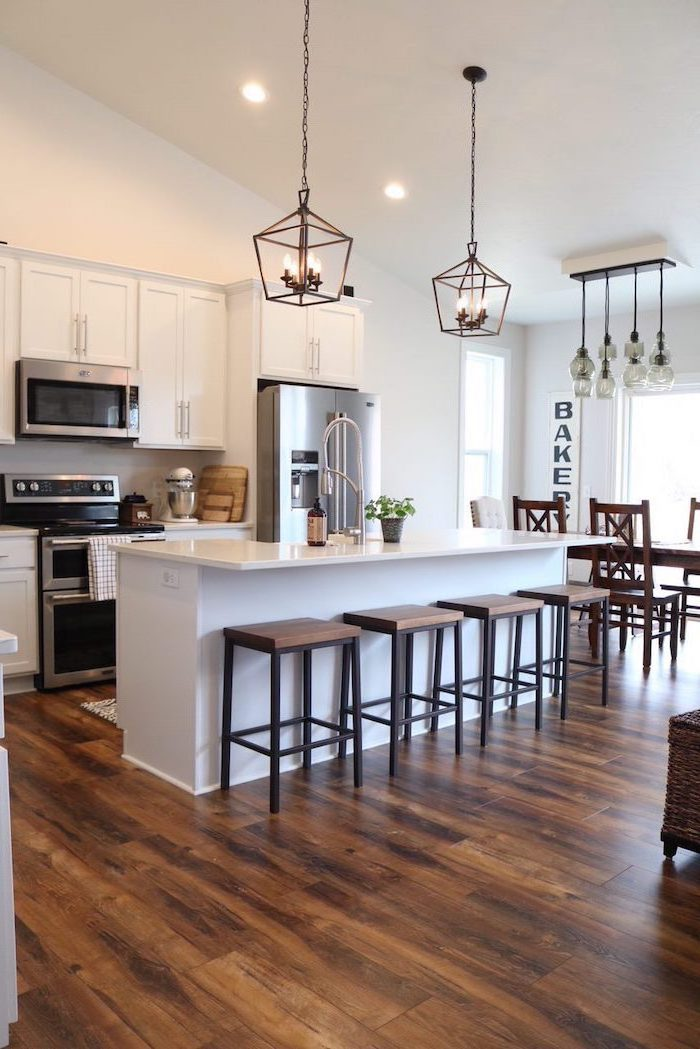 black metal bar stools modern farmhouse decor ideas white kitchen island and cabinets with white countertops dark wooden floor