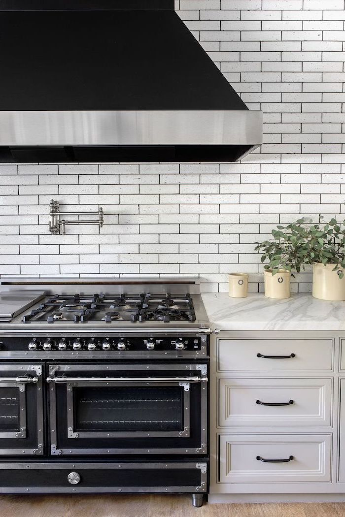 black stove and kitchen hood backsplash for white cabinets white subway tiles white cabinets marble countertop