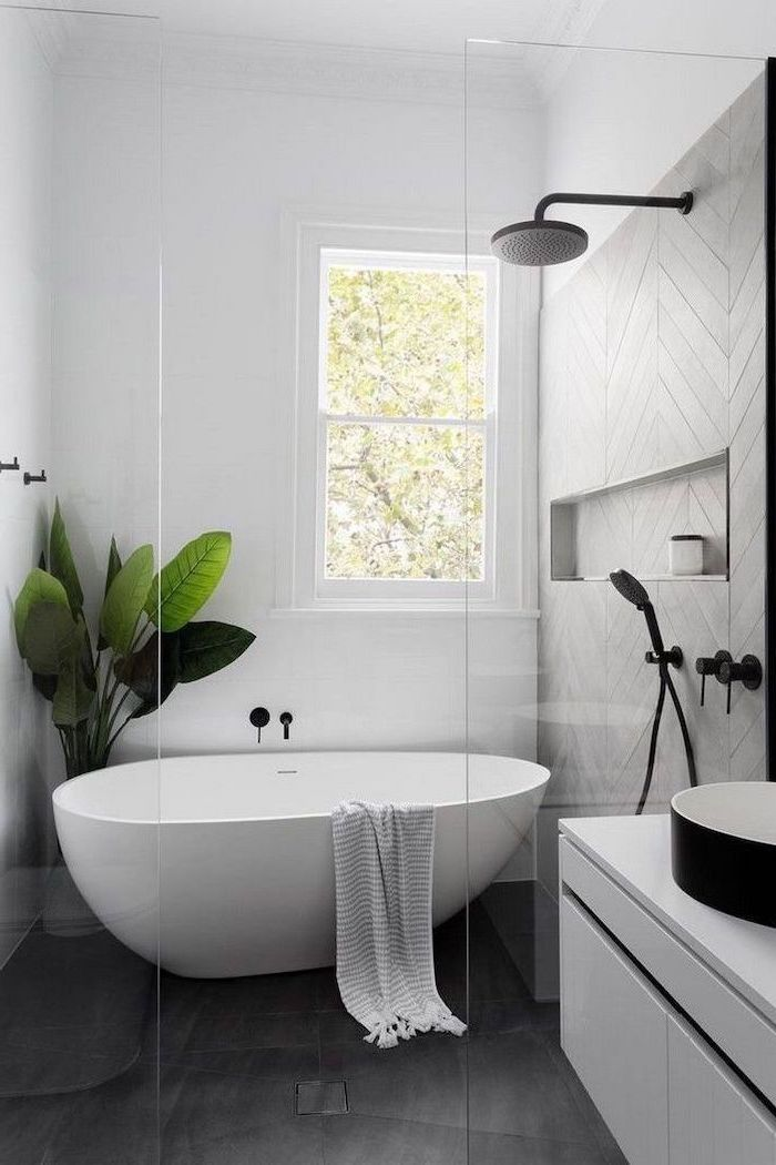 black tiles on the floor grey tiles on the wall in the shower cabin white bathtub bathroom decor pictures