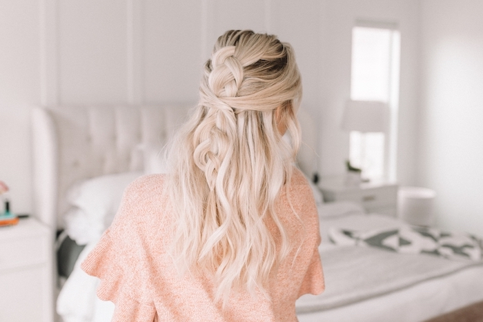 blonde woman with dark roots wearing pink blouse easy hairstyles for school half of her wavy hair in a braid