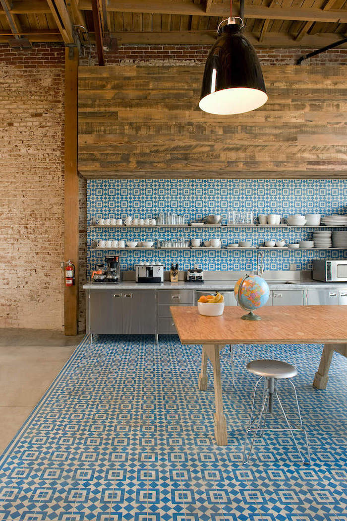 blue and white patterned tiles matching on the floor and wall open shelving with long shelves how to tile a backsplash stainless steel cabinets